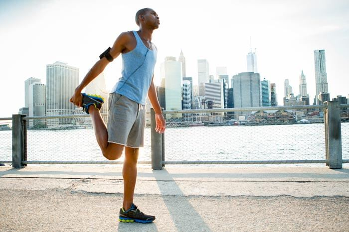 Man stretching in New York getting ready for a run
