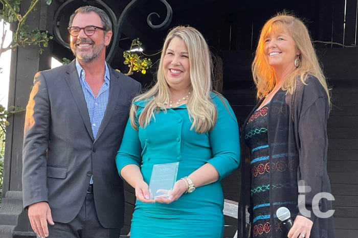 Shot of a businesswoman being awarded a prize during an awards ceremony outdoors