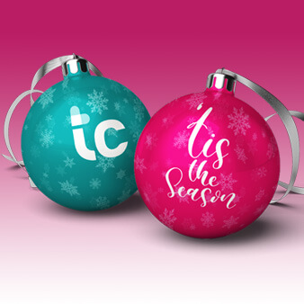 two Christmas balls sitting on a white background